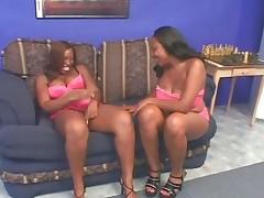Lesbian scene with BBW ebonies licking honeypot