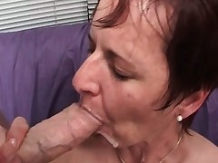 Wicked dark-haired MILF blows stiff cock part1