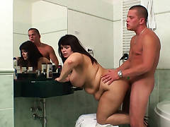 Cheating sex in the bathroom with busty mom
