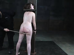 Bound slave punished with pile before flogged