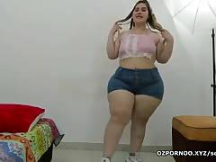 Super huge girl does striptease while singing