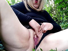 Powerful orgasm of Russian mom in outdoors