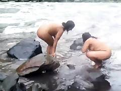 Two indian mature womens  bathing in river naked