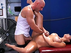Pretty young brunette chick Diamond Kitty is lounging on massage couch and getting her boobs oiled up and anus cussed out by Johnny Sins.