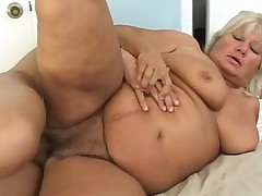 Chunky mature woman invites a black stud to please her sexual urges