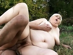 Wild mature chick with thick boobs gets screwed by a masked man outside