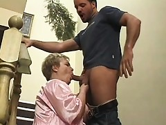 Chubby mature lady fervorously bonks a youthfull stud's dick on the stairs