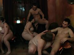 Chubby party lady guzzles cocks from both sides